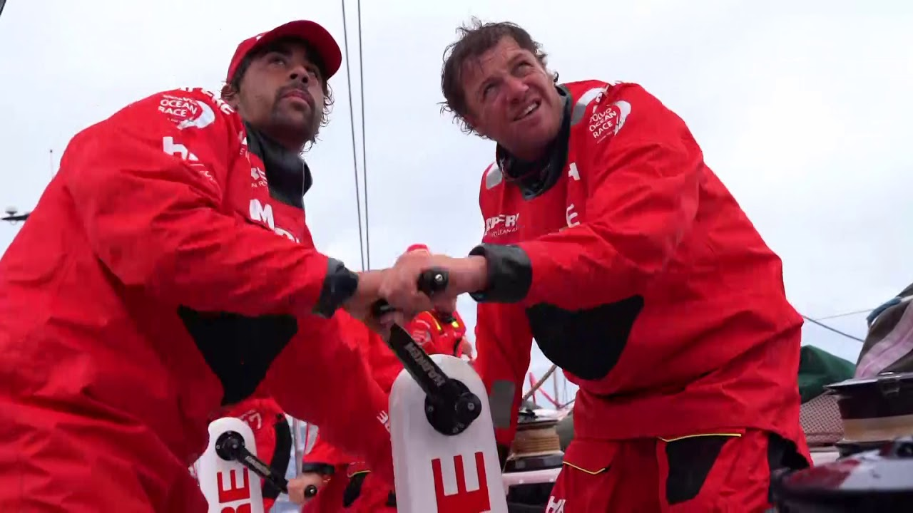 Neti, on the aft pedestal, talks in Spanish. Blair: Sailed well through the night. Dongfeng pulled away from us in the reaching conditions. Just got the sched, Dongfeng is 30 miles away. Rest of the fleet didn't come with us. Massive split. It's a little bit of a worry that Brunel has got separation from us. Because we did well we got further to leeward, and got out of the breeze and gybed. Just one of those things; you've gotta sail the wind you've got. Joan at the nav station, talking to Xabi about when to gybe. Pablo sleeping sitting up. Gybe on deck with Neti and Willy grinding. Stacking. Joan and Rob talking. Rob on the helm. Slomo washing machine. Drone shots of surfing with clouds. Super low-altitude drone shot from just in front of the bow.