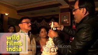 Bengali groom puts topor (conical headgear) on a wedding day