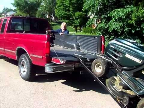 one man ez load system young lady loads a large riding mower mower onto the bed of a pickup. Black Bedroom Furniture Sets. Home Design Ideas