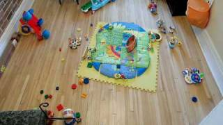 time lapse of a baby playing with his toys
