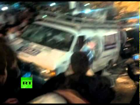 Penn State riot video: Crowd tips over TV van