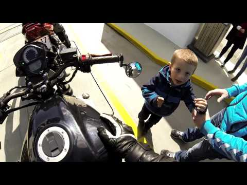 Kid revs bike and gets scared.