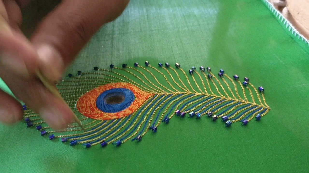 peacock feather design mirror beads and thread stitch