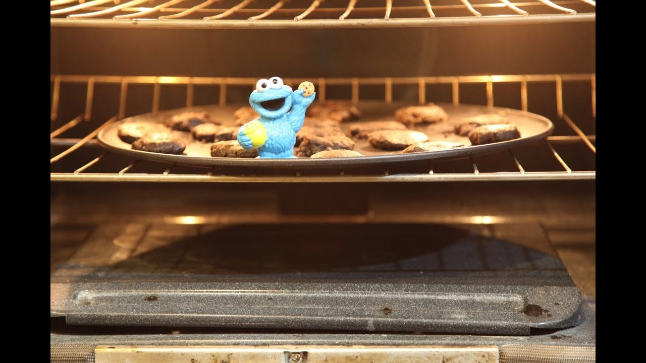 cookie monster bakes cookies and bakes in the oven sesame