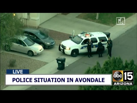 Air15 over police situation in Avondale as a person is on a roof