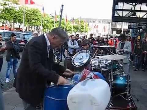Amazing Street Musician play drums in railway station  Hamburg GER