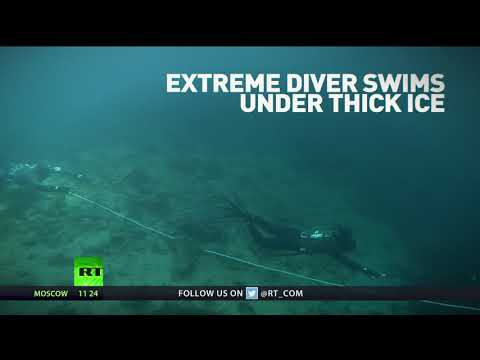 Breaking the ice! Russian chill-seeker dives into freezing waters of Lake Baikal