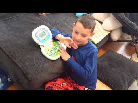 Autistic boy stimming with Leap Frog tablet