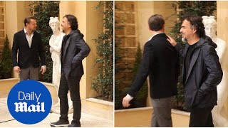 Leonardo DiCaprio pokes fun at statue during photo call in Rome - Daily Mail