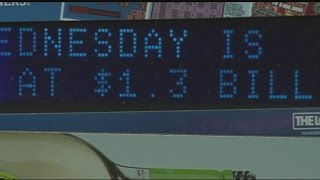 Local residents rush to buy tickets for Wednesday s Powerball drawing