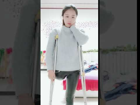 Chinese LAK amputee one leg girl on double crutches