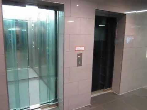Osma Traction Glass Elevator At A Parking Garage In