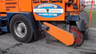 Cleaning up after the asphalt mill with a street sweeper