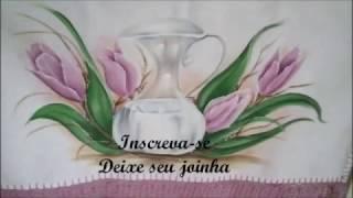Aula completa de jarro transparente com tulipas