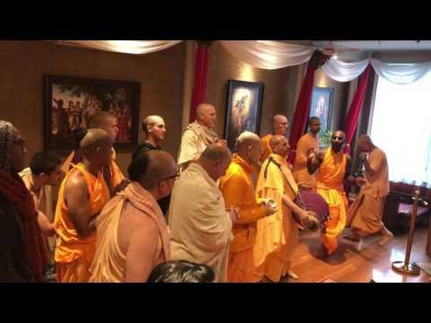 Radhanath Swami chants Sri Guru Carana Padma and Vaisesika Prabhu performs Guru Puja.
