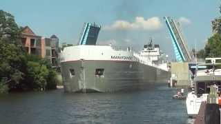 Manitowoc Great Lakes Freighter Navigates Narrow Channel In Manistee Michigan