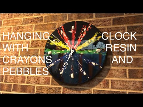 DIY Clock made with crayons, pebbles, and resin