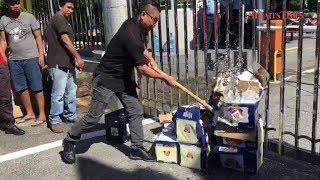 Jamal Yunos smashes crates of beer at SUK entrance, leaves others to clean up mess