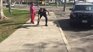 Watch Police Officer Play Hopscotch With Homeless 11-Year-Old