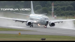 Steep Bank to final and powerful reverse thrust spray Boeing P-8 Poseidon landing on wet runway