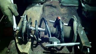 Как выкрутить гайку штока стойки амортизатора