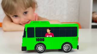 Alena and Pasha play with little Buses