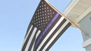 Blue Lives Matter flag forced down, deemed 'racist' thumbnail