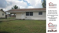 900 Northeast 21st Street, Belle Glade, FL Presented by The Edwards Real Estate Group.