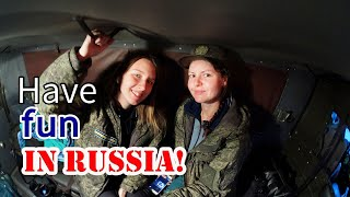 Russian girls show how to hitchhike in Russia. Cities in Siberia