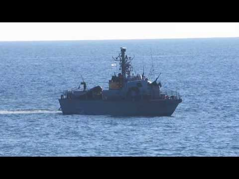 Rosh Hanikra (border between Israel and Lebanon) and a fast patrol boat of the Israeli Sea Corps