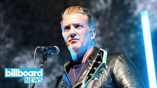 Josh Homme Issues Apology to Photographer He Kicked During Concert | Billboard News