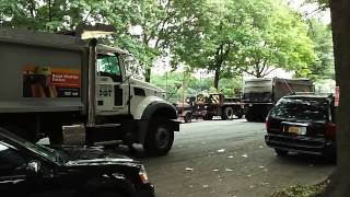 NYC DOT Dump Trucks Carrying Asphalt Wait To Be Put To Use During Re-pavement  On Morrison Ave