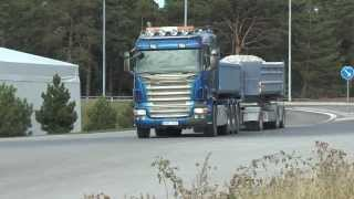 Many Scania trucks carrying crushed stone to a large building on Gotland 2013