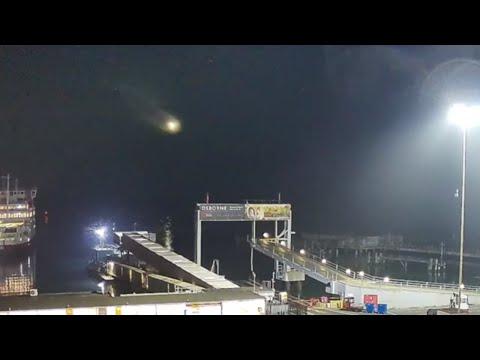 Meteor Sails Across Night Sky Over Southampton Port