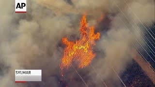 Wind-driven fire near Los Angeles threatens homes