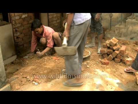 Masons at work in India - good old fashioned manual labour