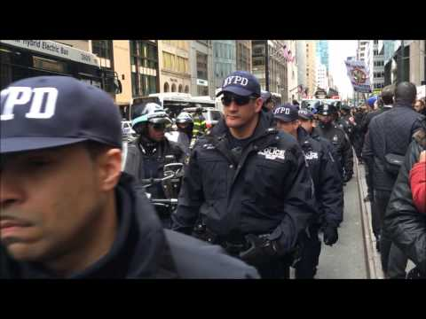 NYPD ESCORTING & MANAGING A ANTI-TRUMP PROTEST MARCH IN MIDTOWN, MANHATTAN, NEW YORK CITY.