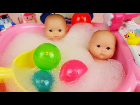 Baby doll bath with surprise eggs and washing machine toys play