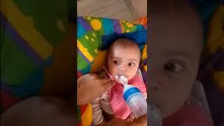 Feeding Milk using Spoon Bottle