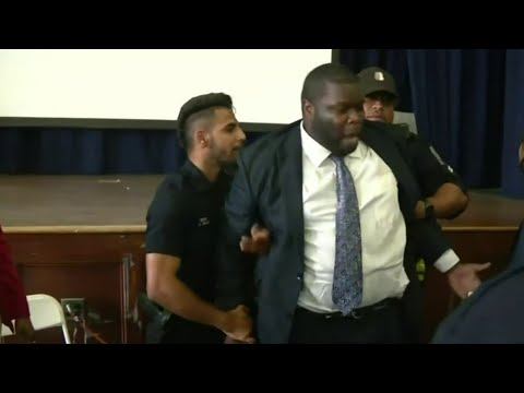 Police commissioner arrested at meeting speaks out