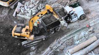 Excavator almost hit by dump truck!!