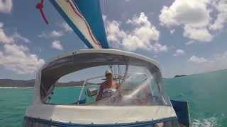 Wife driving boat along Whitehaven Beach Whitsundays