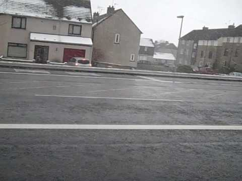 Snow falls in  Aberdeen