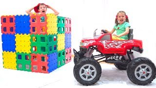 Max And Katy Playing With Blocks And Cars