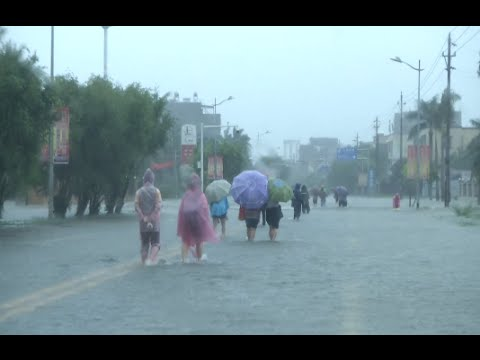River Overflows Banks to Flood a Hainan County in South China