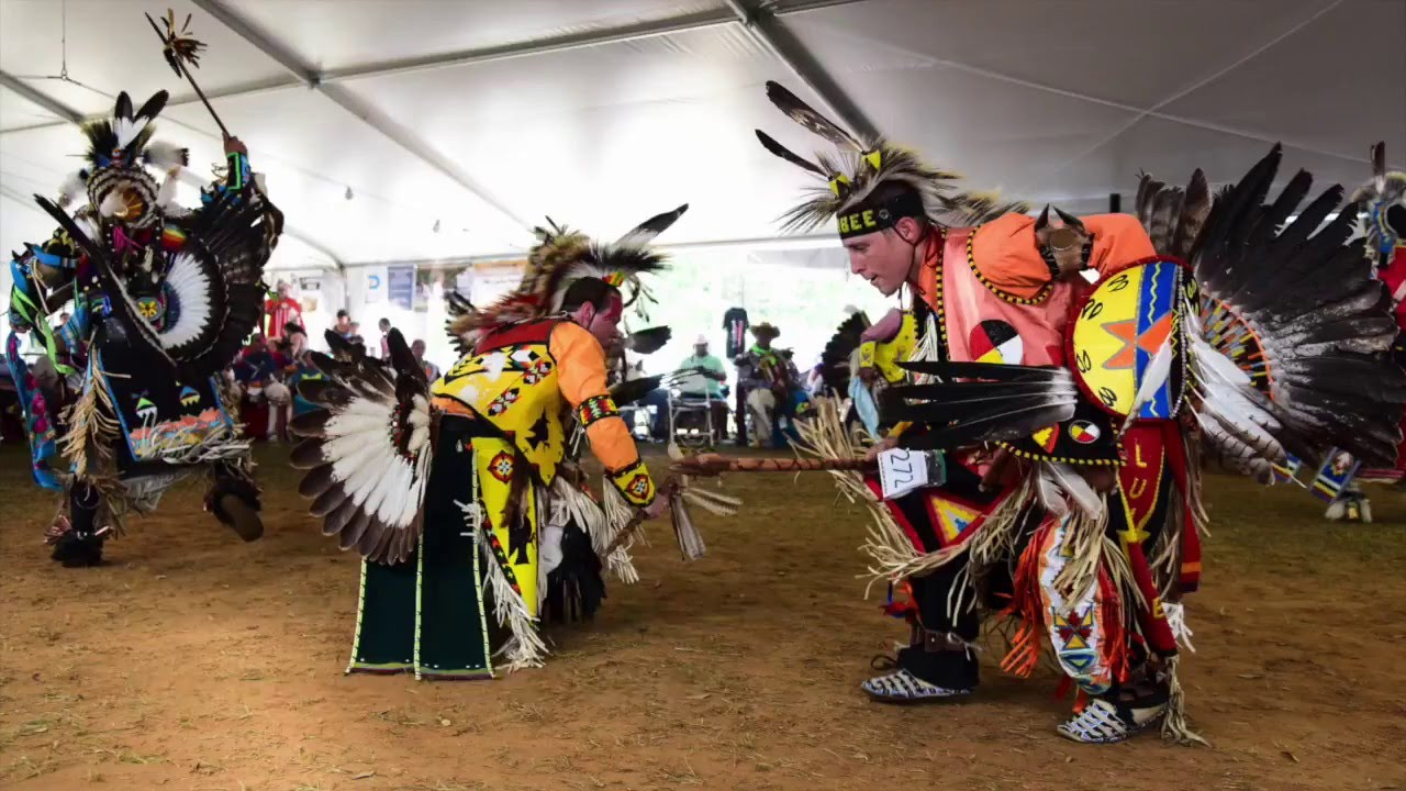 """The Southern Eagle drum group perform a contest song at the """"Dance of the Spring Moon"""" Lumbee powwow"""