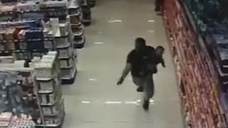 Cop Shoots and Kills 2 Robbery Suspects While Holding Infant Son thumbnail