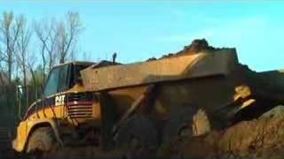 Cat 730 Articulated Dump Truck - Lake Operation