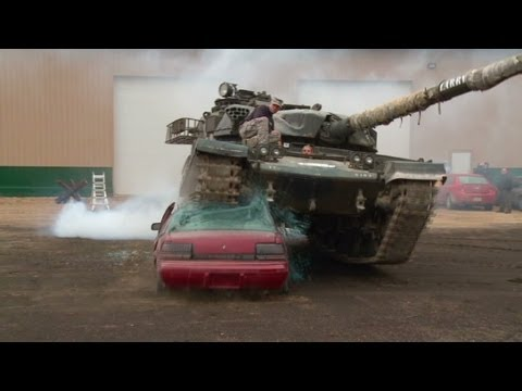 Poppy Harlow crushes car with tank!