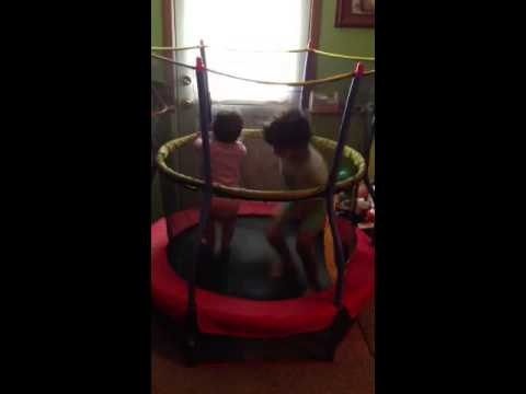 Kids jumping on a tiny trampoline